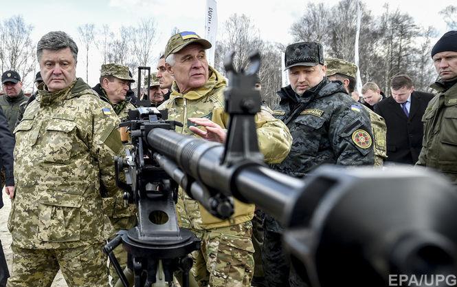 President of Ukraine Petro Poroshenko (left) inspecting military equipment
