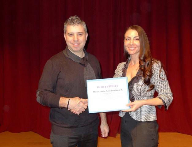 "Natalka Volya presents the ""Mirror of the Freedom Award"" to filmmaker Evgeny Afineevsky"
